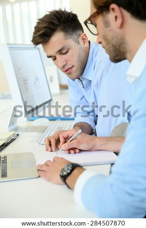 Businessmen in work meeting with laptop computer
