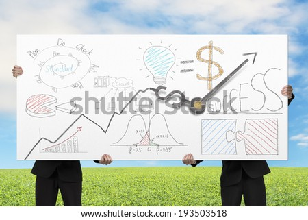Businessmen lifting board with clock hands and business doodles in nature background - stock photo