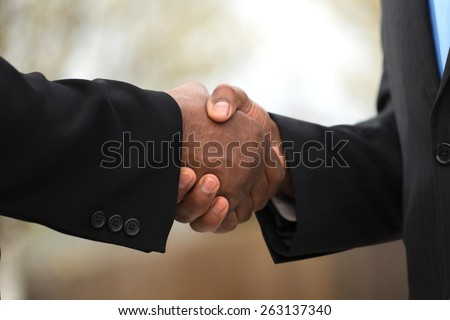 Businessmen making a deal - stock photo