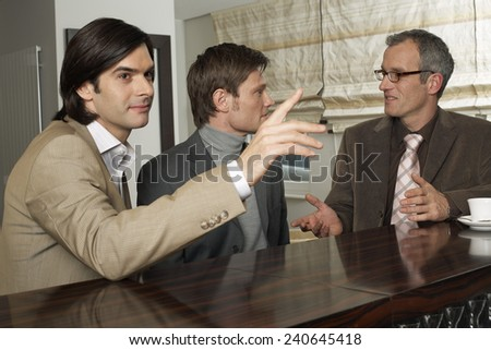 Businessmen Meeting at a Bar - stock photo