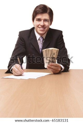 Businessmen passing money with contract - stock photo