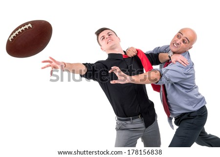 Businessmen playing rugby isolated in white - stock photo