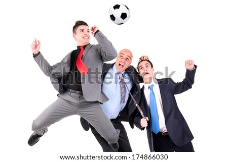 Businessmen playing soccer ball isolated in white
