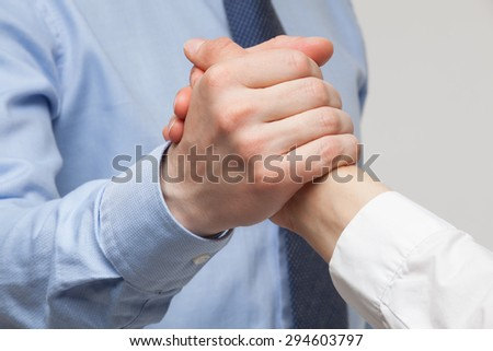 Businessmen's hands demonstrating a gesture of a strife or solidarity, white background
