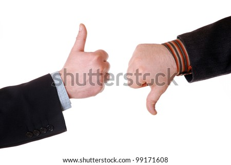 businessmen`s hands with thumb up and thumb down - stock photo