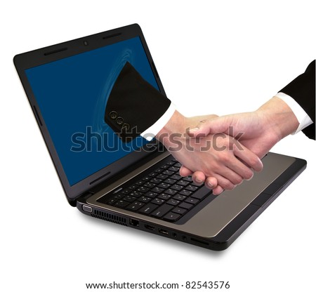 Businessmen shake hands from laptop - stock photo