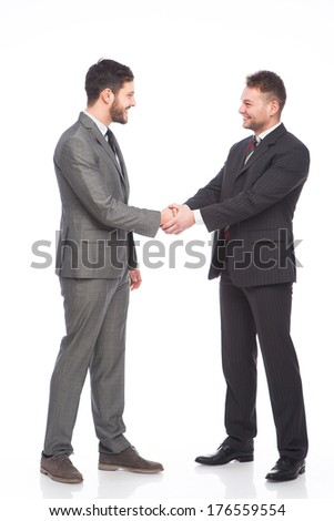 businessmen shaking hands an smiling, on white background - stock photo