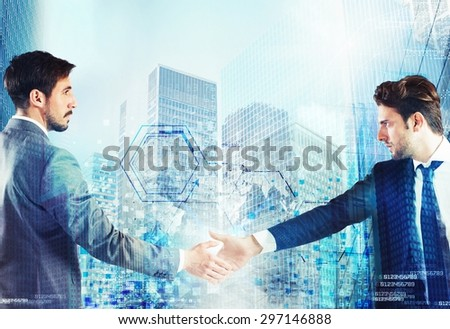 Businessmen shaking hands for a work agreement - stock photo
