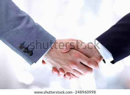 Businessmen shaking hands, isolated on white - stock photo