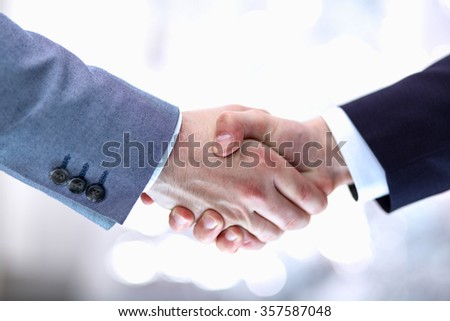 Businessmen shaking hands, isolated on white background - stock photo