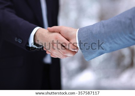 Businessmen shaking hands, isolated on white background