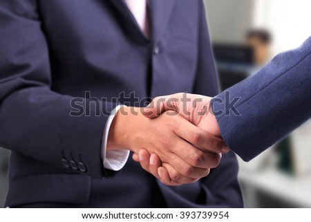 Businessmen shaking hands making an agreement - stock photo