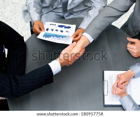 Businessmen shaking hands. Top View - stock photo