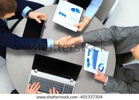 Businessmen shaking hands. Top View - stock photo