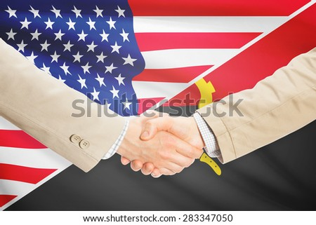 Businessmen shaking hands - United States and Angola