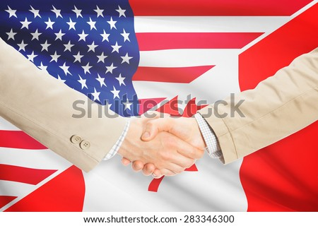 Businessmen shaking hands - United States and Canada - stock photo