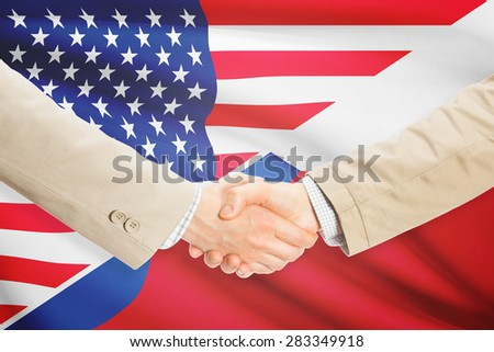 Businessmen shaking hands - United States and Czech Republic