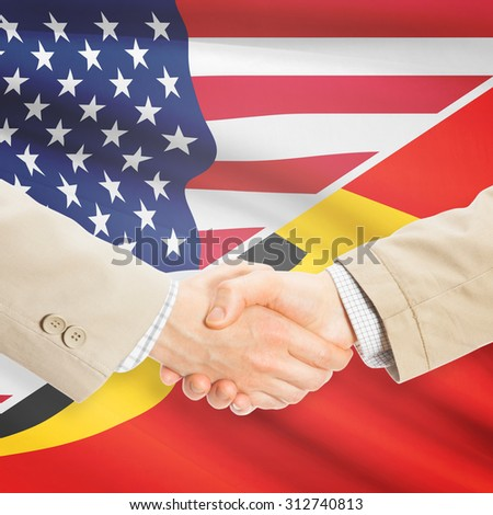 Businessmen shaking hands - United States and East Timor
