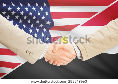 Businessmen shaking hands - United States and Egypt
