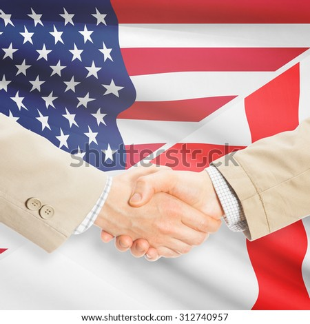 Businessmen shaking hands - United States and England