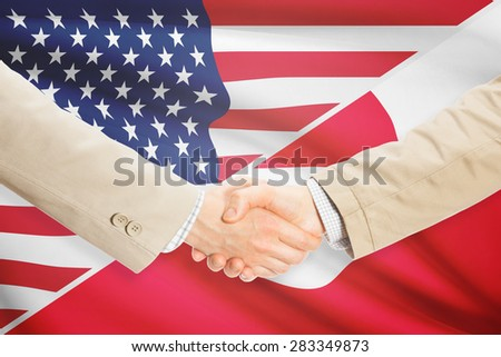 Businessmen shaking hands - United States and Greenland