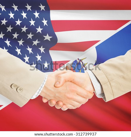 Businessmen shaking hands - United States and Haiti