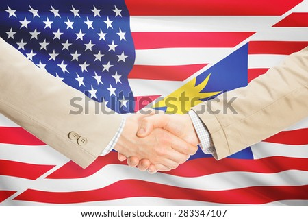 Businessmen shaking hands - United States and Malaysia