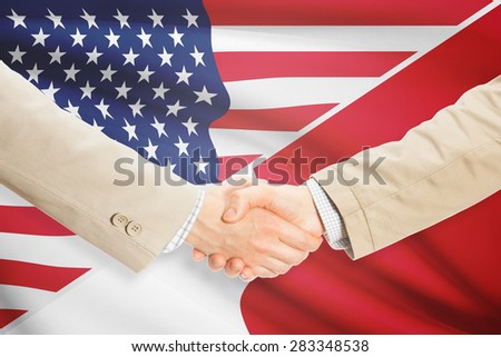 Businessmen shaking hands - United States and Malta