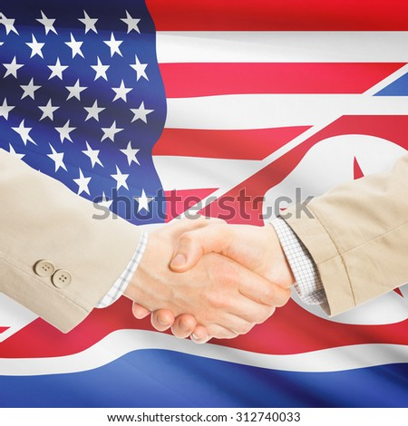 Businessmen shaking hands - United States and North Korea