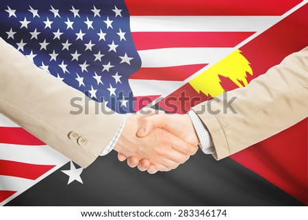 Businessmen shaking hands - United States and Papua New Guinea