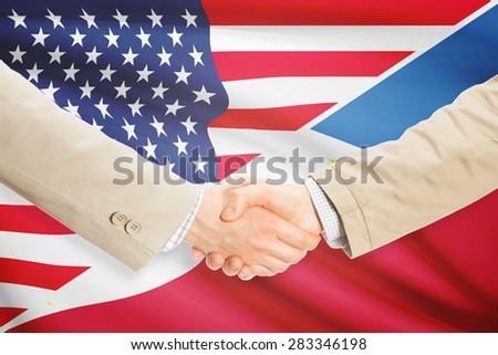 Businessmen shaking hands - United States and Philippines