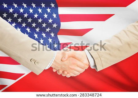 Businessmen shaking hands - United States and Poland - stock photo