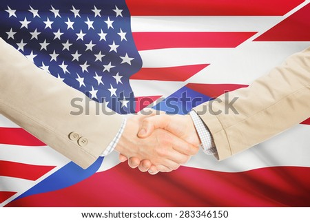 Businessmen shaking hands - United States and Puerto Rico