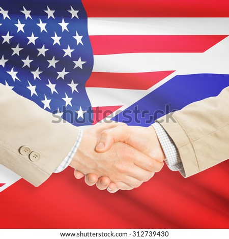 Businessmen shaking hands - United States and Russia