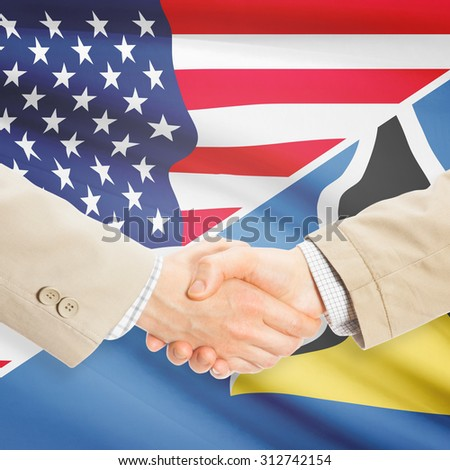 Businessmen shaking hands - United States and Saint Lucia