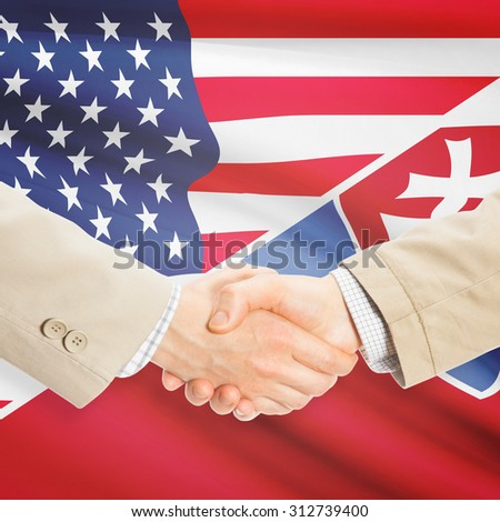 Businessmen shaking hands - United States and Slovakia