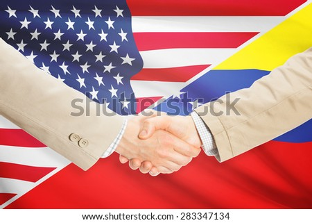 Businessmen shaking hands - United States and Venezuela