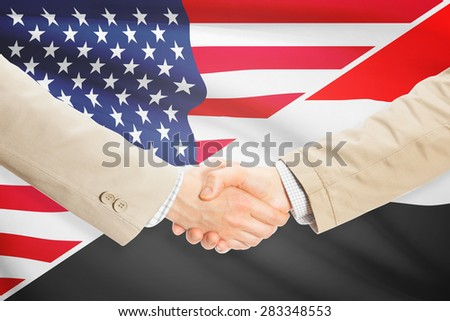 Businessmen shaking hands - United States and Yemen
