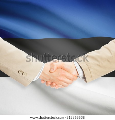 Businessmen shaking hands with flag on background - Estonia