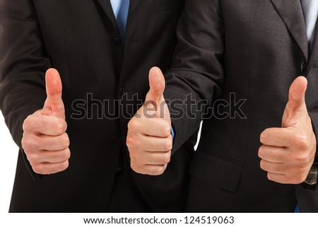 Businessmen showing their thumbs up