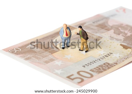 businessmen standing on euro banknotes, financial deal concept, isolated on white with clipping path - stock photo