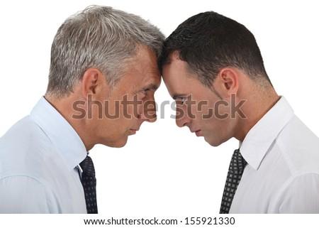 Businessmen stood head-to-head - stock photo
