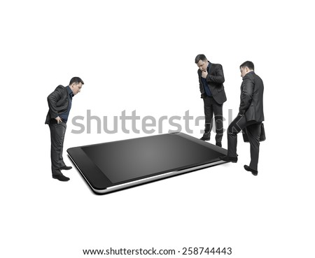 Businessmen take counsel, looking at huge display of tablet computer. On a white background. Conceptual image.