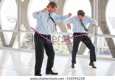 Businessmen taking a play Break in a modern office to get ideas flowing - stock photo