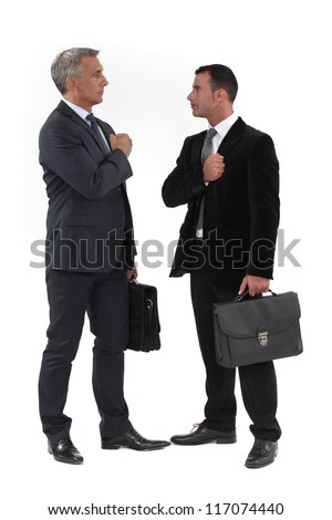 Businessmen trying to build up their morale before an important meeting - stock photo