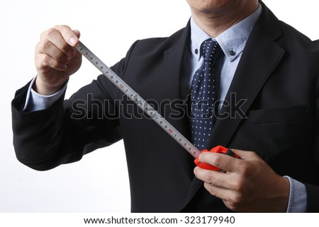 Businessmen use to measure - stock photo