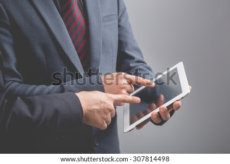 Businessmen using touchpad,,Investment concept