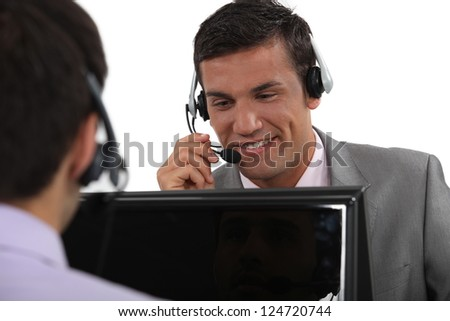 Businessmen wearing headsets - stock photo