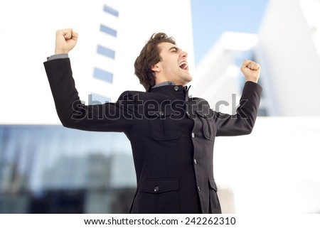 Businessmen with arms up celebrating his success - stock photo