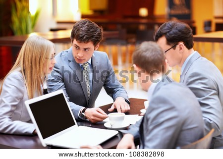 Businessmen with laptop in a meeting at the office - stock photo